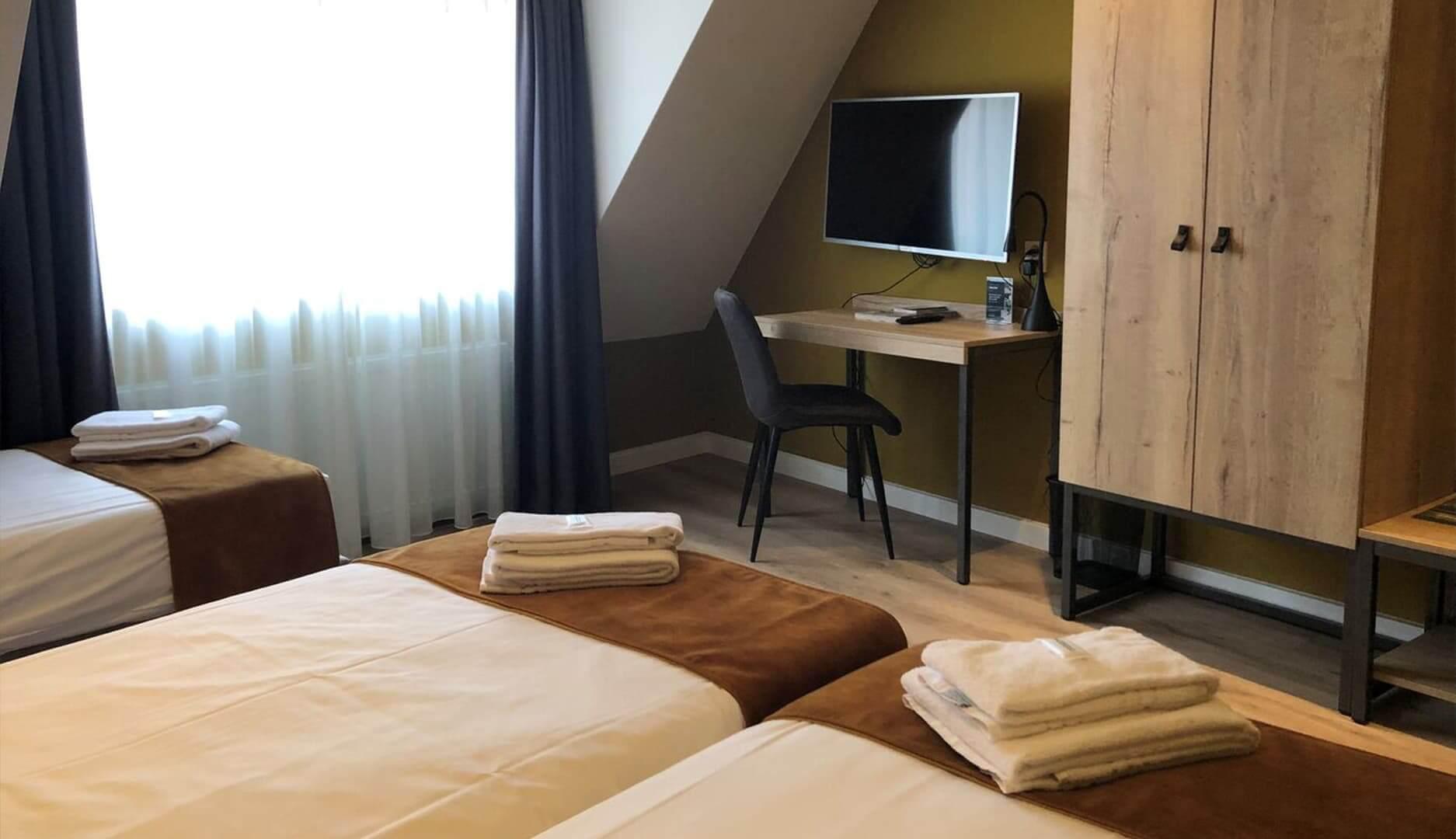 Comfort driepersoonskamer (single beds)2